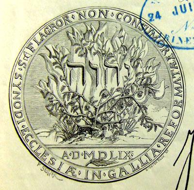 Sceau de l'Église réformée de France représentant le buisson ardent avec la mention du nom de Dieu : YHWH, Jéhovah.
